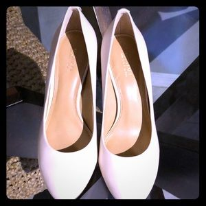 Cream Michael Kors shoes.